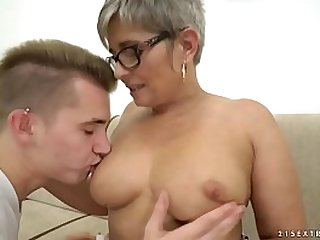 Grandma deepthroats a young dick before riding on it