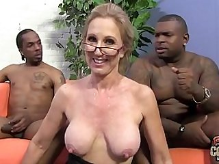 Two black guys are in love playing with granny teacher