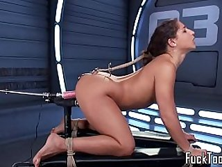 Restrained babe fucks her pussy toyed by dildo machine