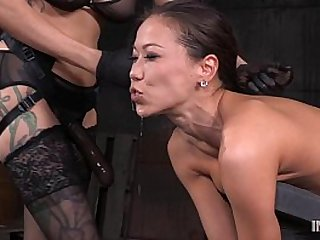 Slender Asian fucked so hard by lezdom strap