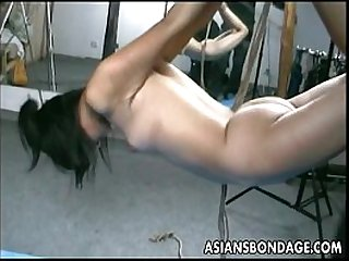Asian lass is hanging around during her bdsm session