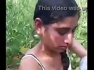 Desi girl removing clothes in field.