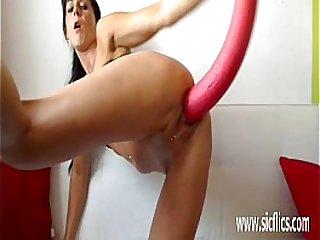 Hot milf fucking a gigantic toy in greedy pussy