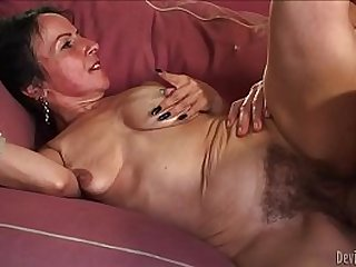 Horny granny Miss Nina Swiss with her hairy cunt