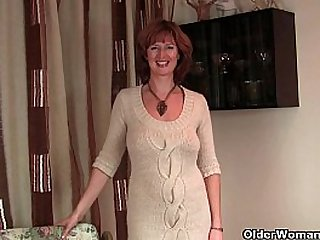 Mature redhead mom gets finger fucked by photographer
