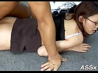 Asian with a large anal plug