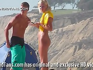 Beautiful blonde teen gets naked on the beach showing her smooth pussy in public!