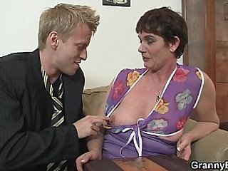 Old granny in stockings gives head and rides fat cock