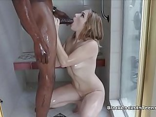 Coed sucking black dick in the shower